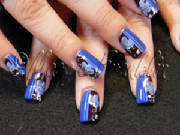 nail art in blue and brown